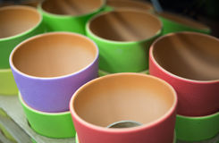 Colored cups for tea and flower vases Royalty Free Stock Photos