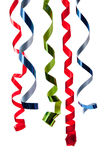 Colored curly ribbon in front of white Stock Photos