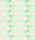 Colored 3D green and orange striped triangles with grid. Seamless geometric background. Modern 3D texture. Pattern with realistic shadow and cut out of paper Royalty Free Stock Photos