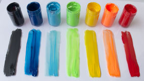 Colored dabs of paint and paint cans Stock Image