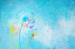 Colored dandelions on blue painting background