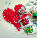 Colored and decorated  gift boxes and red heart Royalty Free Stock Image
