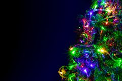 Colored decoration of Christmas tree on dark background. stock photos