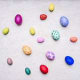 Colored decorative easter eggs  white wooden background top view close up Royalty Free Stock Photo
