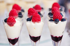 Colored desserts provided in glass jars stock photo