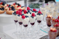 Colored desserts provided in glass jars stock photography