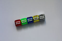 Colored dice on the desk Stock Images