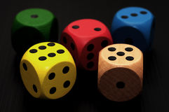 Colored dice. Five colored dice over black Stock Image
