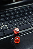 Colored  dices on keyboard - on line gambling concept Stock Photography