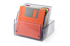 Colored diskettes in a transparent box. Royalty Free Stock Photo