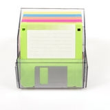 Colored diskettes in a transparent box Stock Photos