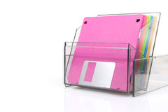 Colored diskettes in a transparent box Royalty Free Stock Photo