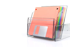 Colored diskettes in a transparent box Stock Images