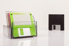 Colored diskettes in a transparent box Royalty Free Stock Photography