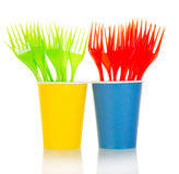 Colored disposable forks in glasses closeup on white Stock Image