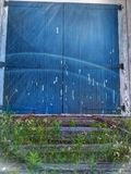 Colored distressed barn doors royalty free stock image