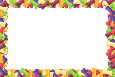 Colored dog biscuit frame Royalty Free Stock Photos