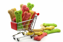 Colored dog biscuits and shopping cart Stock Photo