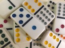 Colored dominoes. An up close look at colored dominos tiles stock image