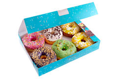 Colored donuts in the blue box. On a white background, isolated Stock Photography