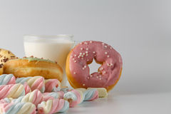 Colored donuts on white plain background Royalty Free Stock Images