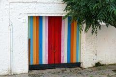 Colored door. Multicolored stripes in a garage door Stock Photography