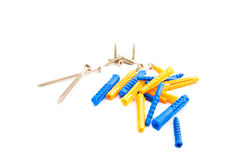 Colored dowels and screws Royalty Free Stock Photo