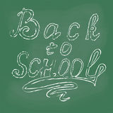 Colored drawing chalk, school supplies, and the inscription back to school. Stock Photos