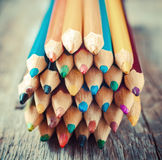 Colored Drawing Pencils on old desk. Vintage stylized image. royalty free stock photo