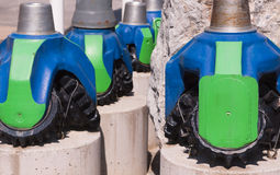 Colored drill chuck. On concrete pedestals Stock Images