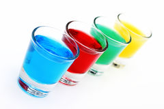 Colored drink. Four glasses with colored drink royalty free stock photography