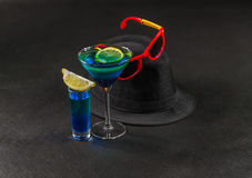Colored drink, a combination of blue and green, lemon, martini g Royalty Free Stock Photography