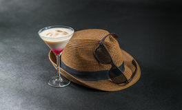Colored drink, a combination of red, beige and violet, martini g. Lass, brown sunglasses, brown stylish hat, party set Stock Images