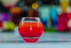 Colored drink in glass for shots, a combination of red with viol. Et, colorful background, drink shot Royalty Free Stock Image