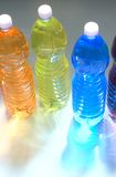 Colored drinks - plastic bottles. Plastic bottles with colored drinkl, backlit Royalty Free Stock Image