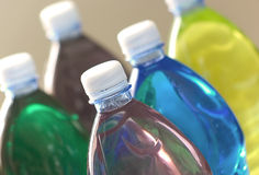 Colored drinks - plastic bottles. Colored drinks in plastic bottles, details, backlit Royalty Free Stock Images