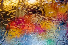 Colored drops on the glass. Red, yellow, green, blue colors Royalty Free Stock Images