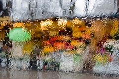 Colored drops on the glass. Red, yellow, green, blue colors Stock Photos