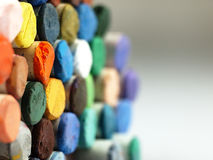 Colored dry pastel crayons closely. Royalty Free Stock Photos