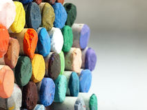 Colored dry pastel crayons closely. Stock Images