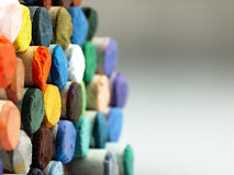 Colored dry pastel crayons closely. Royalty Free Stock Photo