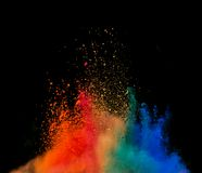 Colored dust explosion on black background. Freeze motion of colored dust explosion isolated on black background Royalty Free Stock Photo