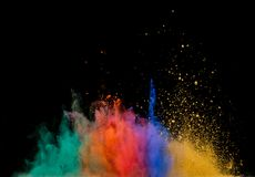 Colored dust explosion on black background Stock Photography