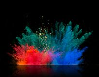 Colored dust explosion on black background Royalty Free Stock Photos