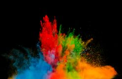 Colored dust explosion on black background Royalty Free Stock Photo