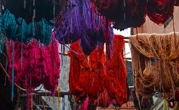 Colored dyed yarn is dried on the streets of Morocco Royalty Free Stock Photos