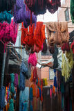 Colored dyed yarn is dried on the streets of Morocco Stock Photo