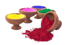 Colored Dyes. Various colored dyes in earthen bowls isolated on white stock photography
