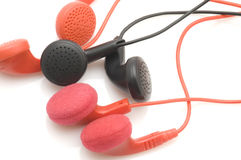Colored ear phones Royalty Free Stock Photo