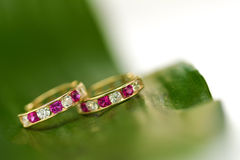 Colored earrings baby Royalty Free Stock Photo